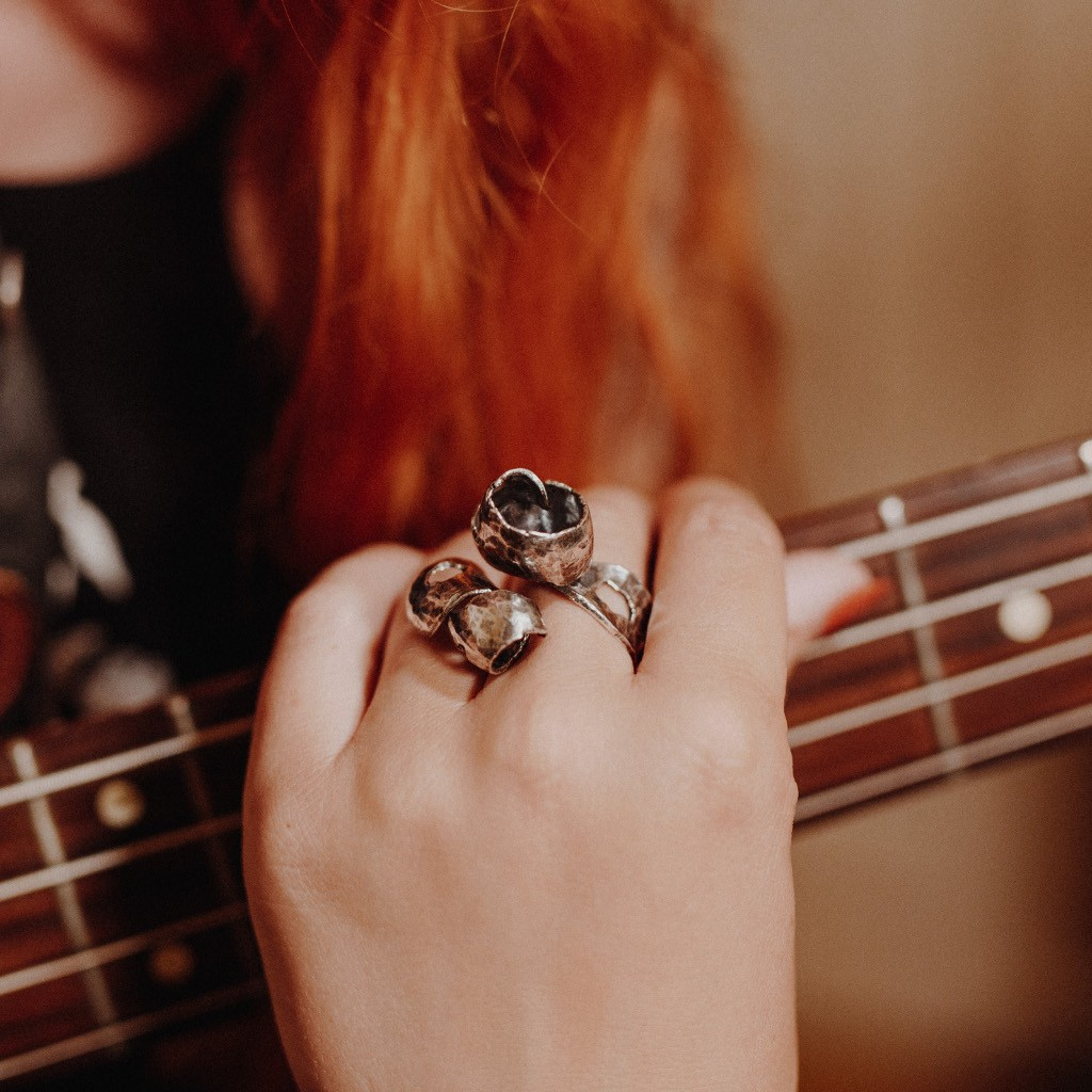 Silver Ring: Guitar Distortion Series no.30 model wears while playing bass guitar