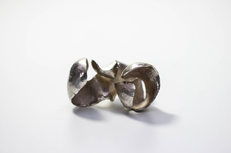 very large silver ring forged from one piece of silver into two billowing lobes over the finger.