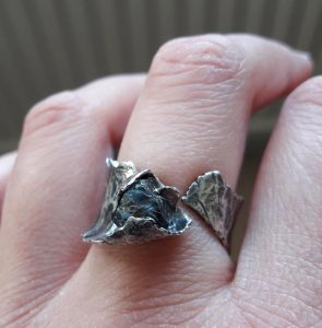rough-luxe natural saphire crystal silver ring, textured and oxidised word on hand