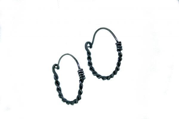Twisted Silver Hoops two earrings on a white background. Blackened silver Celtic style ear hoops