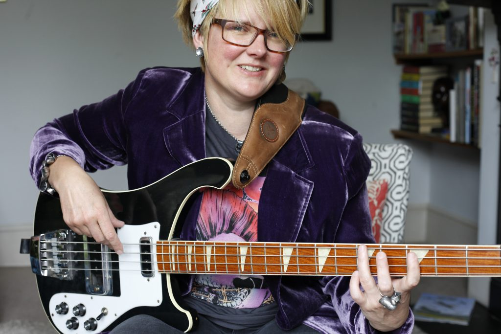 Poppy Porter Playing Rickenbacker Bass guitar