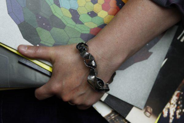 Silver Bangle Statement Bracelet model image with vinyl LPs