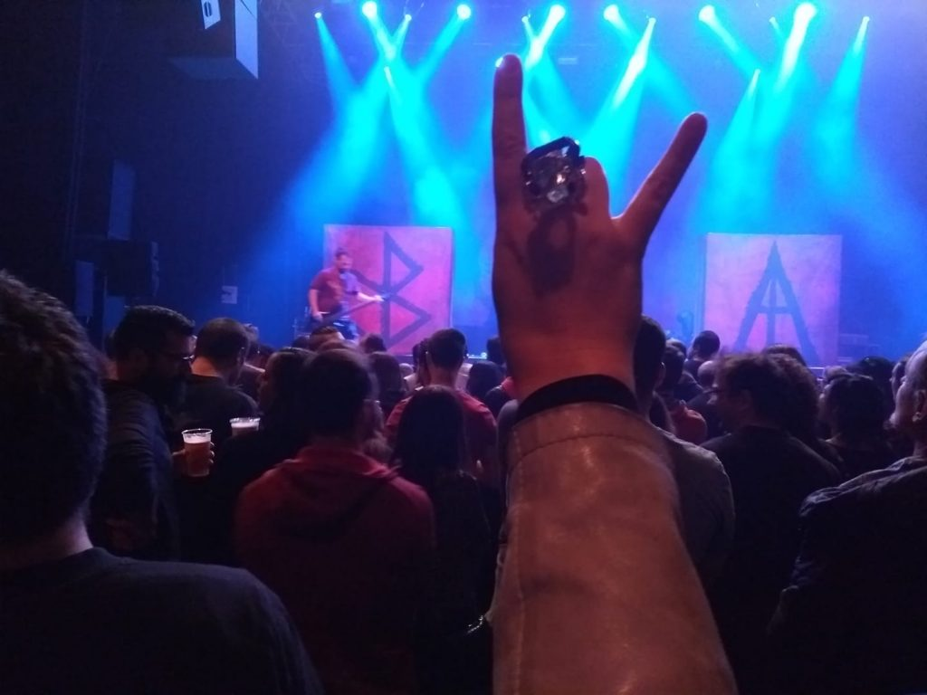 Photo sent by customer wearing her bespoke ring at a gig